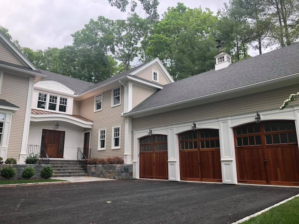 Home with three brown garage doors